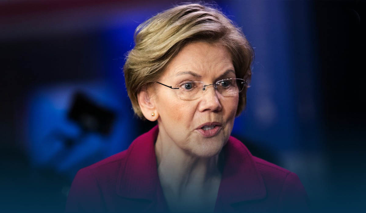 Warren backs Biden in raising record $6 million